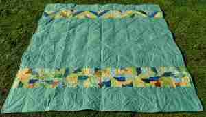 Back of quilt made in batik fabrics by Hoffman