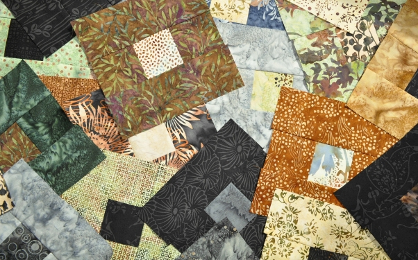 Random patchwork blocks made of Hoffman Bali Pops for a quilt