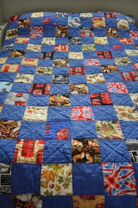 Single bed patchwork quilt with alternating blue and British iconic fabric
