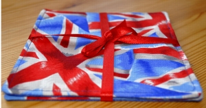 Two Union Jack fabric drink coasters tied with red ribbon